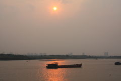 A Boat in the Red River Sunset Hanoi Royalty Free Stock Photos