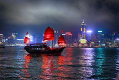 Hong kong, night city, lights, scarlet sails, river, blue sky, c royalty free stock photography