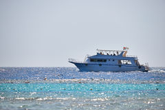 Boat on Red Sea. A boat sailing in the Red sea, photographed in backlight Royalty Free Stock Image