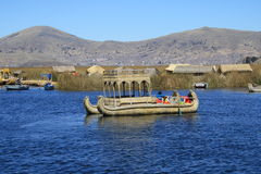 Boat of reeds. On Lake Titicaca , floating islands in background Stock Photography