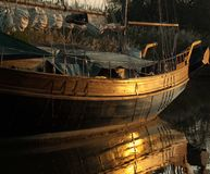 Boat reflecting in water Royalty Free Stock Photo