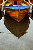 Boat Reflection. Reflection of small boat moored in shallow water Royalty Free Stock Photography