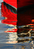 Boat reflection. Brightly coloured reflection of a boat royalty free stock photography