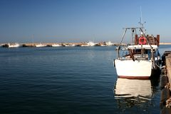 Boat reflection. Image of a boat reflection in Giulianova sea-port Stock Image