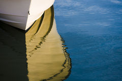 Boat Reflection. A boat sits in the harbor with its' reflection in the water Stock Photos