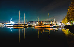 Boat Reflection. Calm water made Clear refletions of the boats. Northern light is visible in the background Royalty Free Stock Images