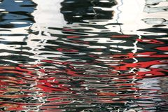 Boat reflection in turbulent river royalty free stock images