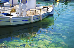 Boat reflection on water Greece Royalty Free Stock Images