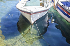 Boat reflection on the water Stock Photos