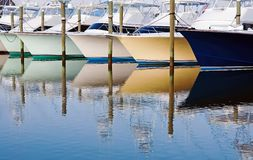 Boat Reflections. Colorful boat reflections in a marina royalty free stock photo