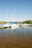 Boat Reflections. Sailboats at the dock with their reflections on the water Royalty Free Stock Photo