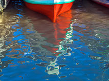 Boat reflections Stock Images