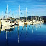 Boat reflections. Sailing boats in Harbour reflections on still water in airlie beach whitsunday islands Queensland Stock Photography