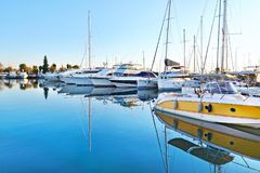 Boat reflections on sea at Alimos marine Greece stock images