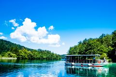 Boat reflexion in the Plitvice Lakes in Croatia Royalty Free Stock Photo