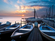 Boat rent. Rental boats in an marina during sunrise Stock Image