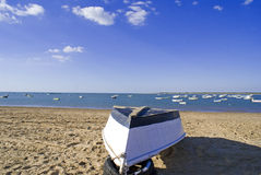Boat on repair. Fishing boat on the beach for repairs before being returned to the rest of the fleet Stock Photography