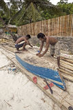 Philippines - Men Repair Boat Stock Photography