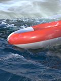 Boat rescue. Rescue ring in the ocean. Background: a sinking sail-boat ship Royalty Free Stock Image