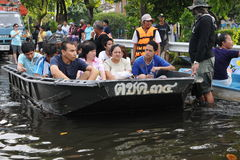 Boat Rescue. People wait for evacuation by mororboat on a flooded street as tens of thousands of city residents are ordered to leave their homes in the worst Stock Image