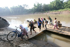 Boat. Residents use the services of a boat crossing to cross the river Bengawan Solo, Central Java, Indonesia Royalty Free Stock Photo