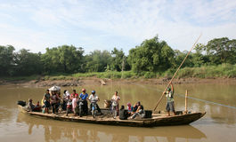 Boat. Residents use the services of a boat crossing to cross the river Bengawan Solo, Central Java, Indonesia Royalty Free Stock Photography