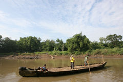 Boat. Residents use the services of a boat crossing to cross the river Bengawan Solo, Central Java, Indonesia Stock Photos