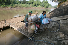 Boat. Residents use the services of a boat crossing to cross the river Bengawan Solo, Central Java, Indonesia Stock Photography