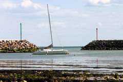 Boat at rest. A small catamaran moored in the harbor at Jard sur Mer on the Atlantic coast in the Vendee, France Royalty Free Stock Photo
