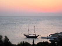 Boat in Rhodos. Wonderfull view of boat in Rhodos Port in the afternoon - sunset over the sea royalty free stock photo