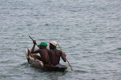 Boat ride in the afternoon. Two young men out in there row boat in Tanzania in the afternoon Stock Photography