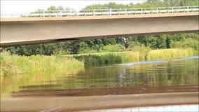 Boat ride along a river, idyllic landscape stock footage