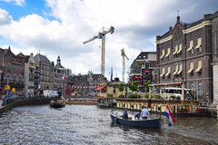 Boat Ride on Amsterdam Canal with ongoing construction in the background Royalty Free Stock Photos