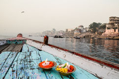 Boat ride on the Ganges, Varanasi, Rajasthan, India. Details of old boat carrying lit candles and flowers Royalty Free Stock Photo