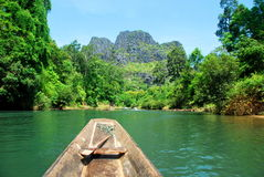 A boat ride on the other side of Kong Lor Cave in Central Laos. A boat ride on the other side of Kong Lo Cave in Central Laos stock photo