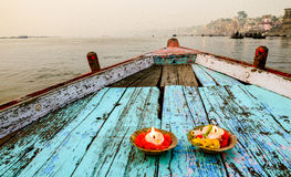 Boat ride on the river Ganges,Varanasi, Rajasthan, India. Early morning cruise along the holy Ganges River and candles lit as offering Stock Photography