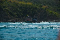 Boat ride and ships in island green mountain ocean sea background royalty free stock image