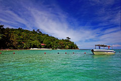 Boat ride to tropical island. Island off Sabah, Borneo Stock Photo