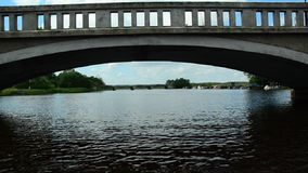 A boat ride under a bridge stock video footage