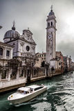 Boat in Rio del Greci near the campanile of church San Giorgio dei Greci, Venice, Italy Stock Image
