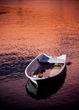 Boat on the river. Fishing boat on the river in the sunset Stock Photo