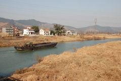 Boat and river. Xixian dyke  in hangzhou with bulrush and a boat in the river Royalty Free Stock Photography