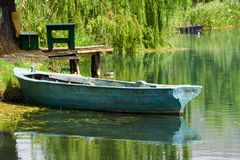 Boat on the river. Blue boat on the river Stock Photos