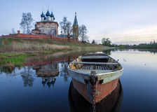 Boat on the river against the background of the Orthodox Church Royalty Free Stock Photos