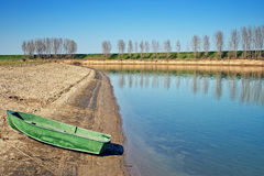 Boat on river bank Stock Image