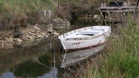 Boat in river channel. Still shot of boat in river channel stock video