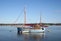 Boat on River Exe. Traditional wooden yacht on River Exe Stock Images
