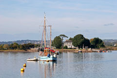 Boat on River Exe. Moored yacht on the River Exe Stock Photography