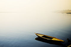 Boat in the River Ganges. A single boat sitting by the river ganges during one morning in Varanasi royalty free stock images