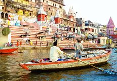 Boat at the river Ganges near holy ghats with people in Varanasi, India early morning ceremony, royalty free stock image